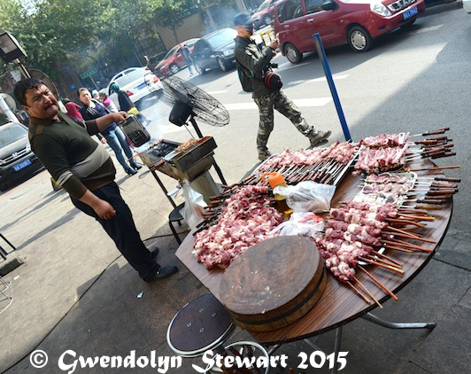 Cooking the Meat Al Fresco, Urumqi, Xinjiang, China, Photographed by Gwendolyn Stewart, c. 2015; All Rights Reserved